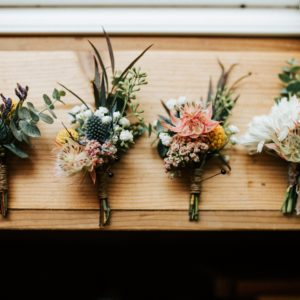 These 10 Winter Wedding Boutonnieres are Sure to Delight