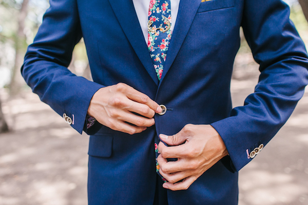 Bright blue suit and patterned tie